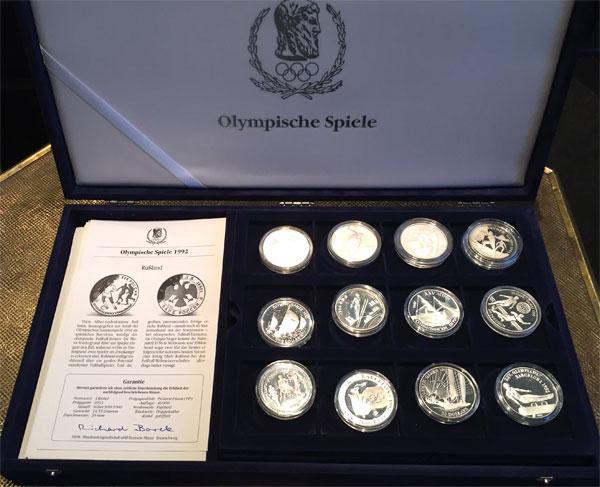 Silbermuenzen in Original Sammelbox Olympische Spiele 1992 vollstaendiger Satz